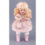 Фарфоровая кукла с мягконабивным туловищем
